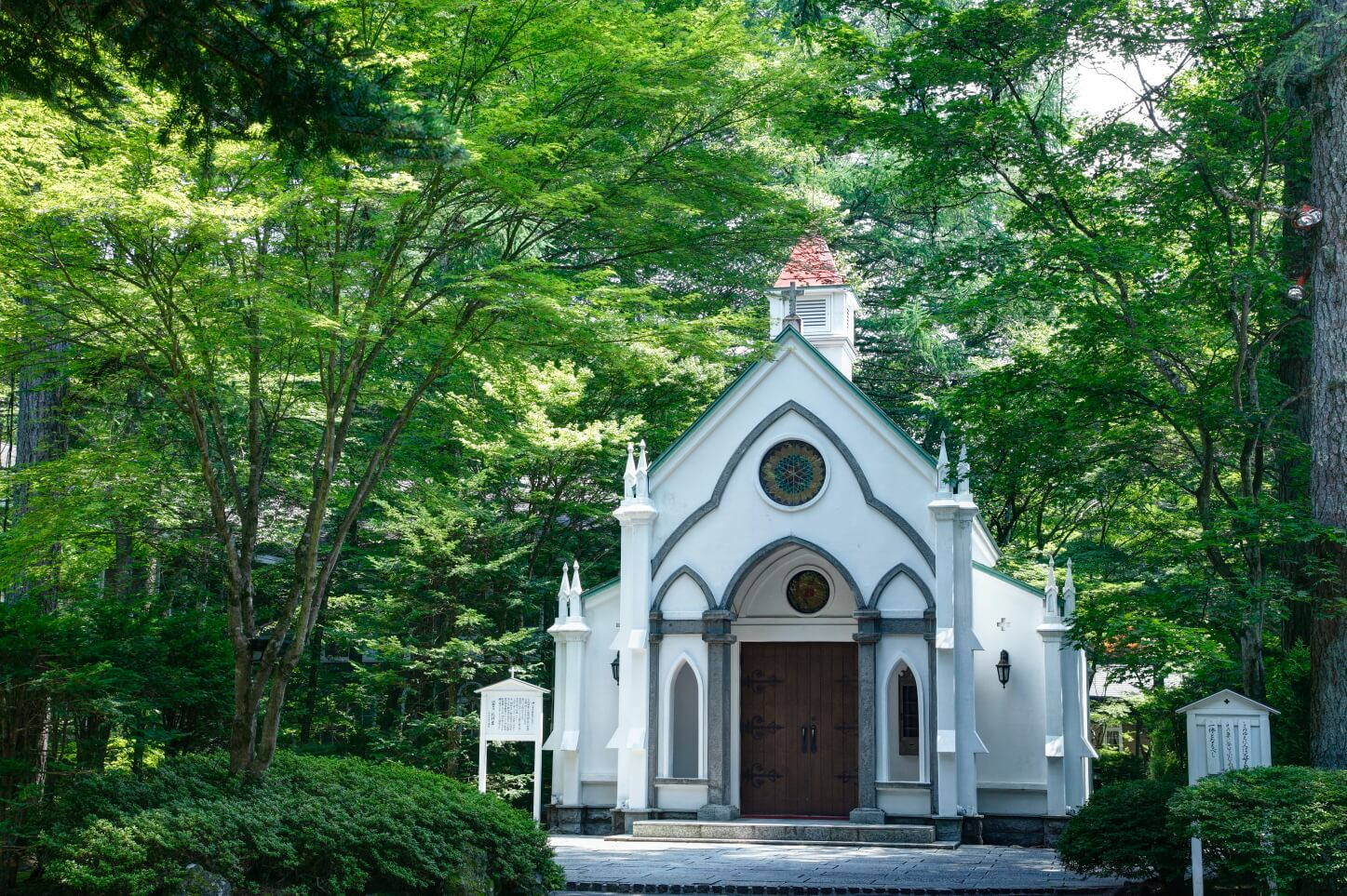 A white chapel in a quiet forest